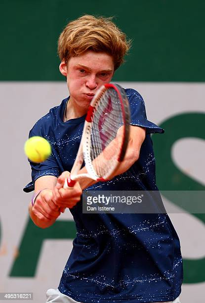 Andrey Rublev of Russia returns a shot during his boys' singles match against Bogdan Ionut Apostol of Romania on day nine of the French Open at...