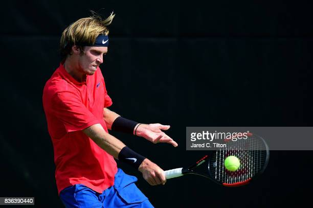Andrey Rublev of Russia returns a shot from Steve Darcis of Belgium during the third day of the WinstonSalem Open at Wake Forest University on August...