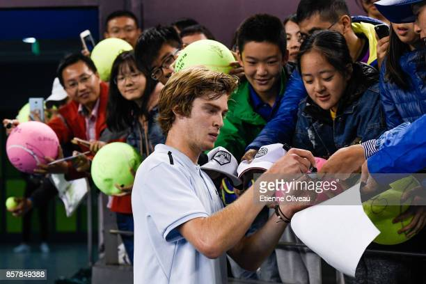 Andrey Rublev of Russia signs an autograph after his victory over Tomas Berdych of the Czech Republic during his Men's singles second round match on...