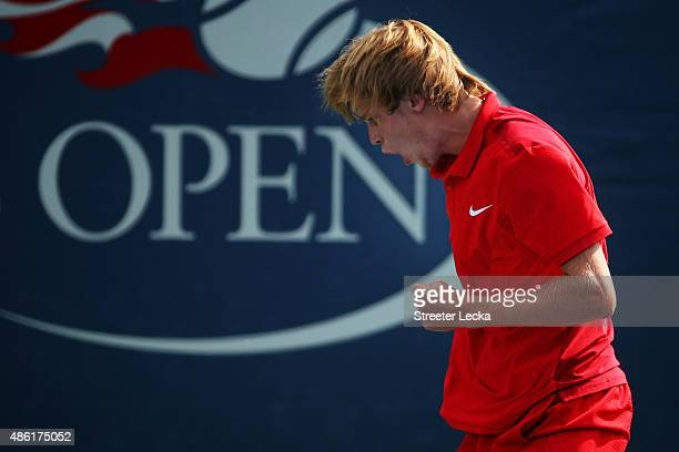 Andrey Rublev of Russian reacts against Kevin Anderson of South Africa during their Men's Singles First Round match on Day Two of the 2015 US Open at...