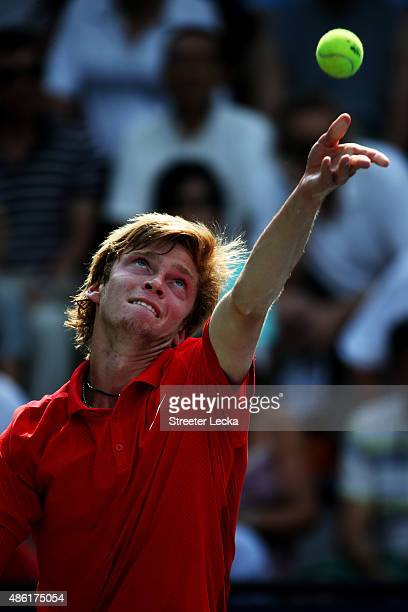 Andrey Rublev of Russian serves against Kevin Anderson of South Africa during their Men's Singles First Round match on Day Two of the 2015 US Open at...