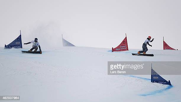 Andrey Sobolev of Russia and Zan Kosir of Slovenia compete in the Men's Parallel Giant Slalom Finals during the FIS Freestyle Ski and Snowboard World...