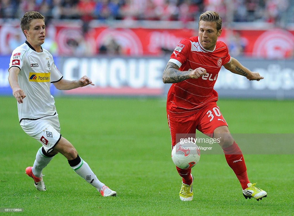 Andrey Voronin of Duesseldorf battles for the ball with Patrick Hermann of Moenchengladbach during the Bundesliga match between Fortuna Duesseldorf...