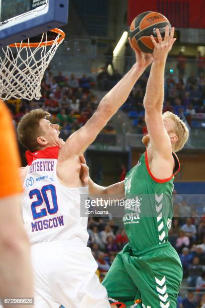 Andrey Vorontsevich #20 of CSKA Moscow competes with Chase Budinger #34 of Baskonia Vitoria Gasteiz during the 2016/2017 Turkish Airlines EuroLeague...