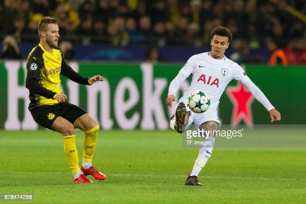 Andrey Yarmolenko of Borussia Dortmund and Dele Alli of Tottenham Hotspur battle for the ball during the UEFA Champions League group H match between...