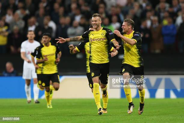 Andrey Yarmolenko of Borussia Dortmund celebrates scoring his sides first goal with Lukasz Piszczek of Borussia Dortmund during the UEFA Champions...