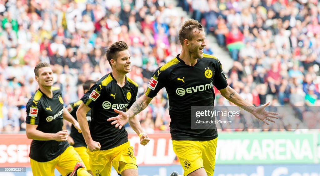 Andrey Yarmolenko of Borussia Dortmund cheers after scoring his team's 1th goal with Julian Weigl during the Bundesliga match between FC Augsburg and Borussia Dortmund at WWK-Arena on September 30, 2017 in Augsburg, Germany.