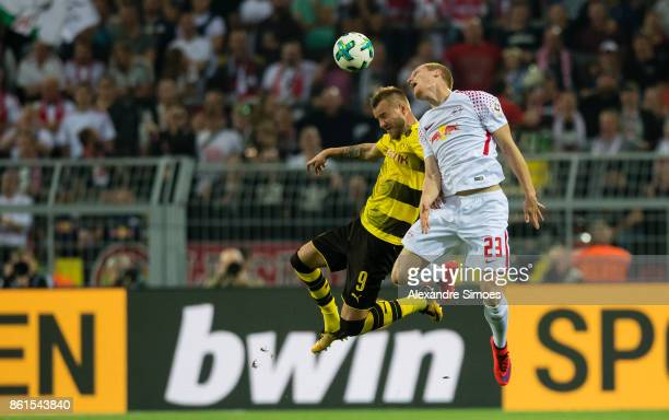 Andrey Yarmolenko of Borussia Dortmund in the battel for the ball against Marcel Halstenberg of RB Leipzig during the Bundesliga match between...