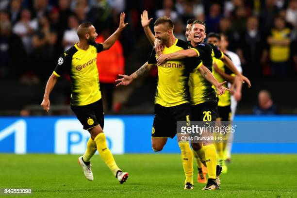 Andrey Yarmolenko of Borussia Dortmund is congratulated by team mates after scoring his sides first goal during the UEFA Champions League group H...