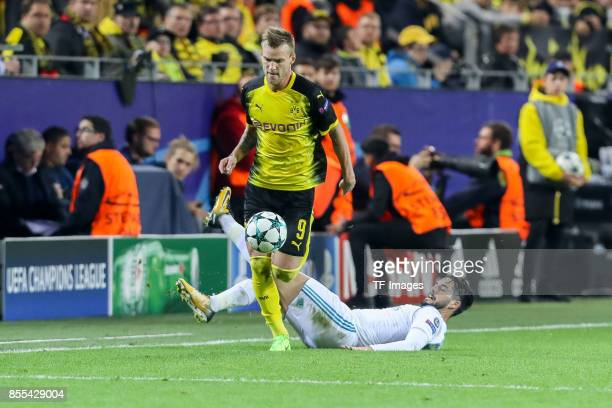 Andrey Yarmolenko of Dortmund and Isco of Real Madrid battle for the ball during the UEFA Champions League group H match between Borussia Dortmund...