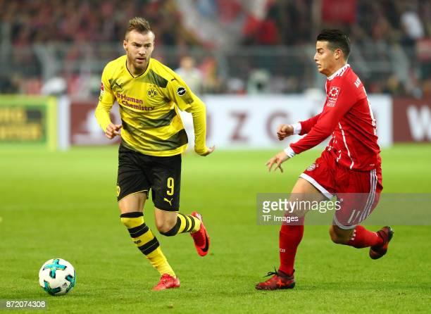 Andrey Yarmolenko of Dortmund and James Rodriguez Rubio of Bayern Muenchen battle for the ball during the German Bundesliga match between Borussia...