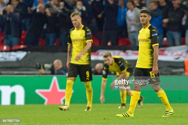 Andrey Yarmolenko of Dortmund and Lukasz Piszczek of Dortmund and Mahmoud Dahoud of Dortmund looks dejected during the UEFA Champions League group H...