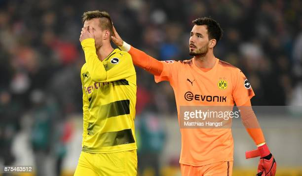 Andrey Yarmolenko of Dortmund and Roman Buerki of Dortmund are looking dejected after loosing the Bundesliga match between VfB Stuttgart and Borussia...