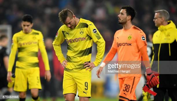 Andrey Yarmolenko of Dortmund and Roman Buerki of Dortmund are looking dejected after loosing the Bundesliga match between VfB Stuttgart and Borussia...