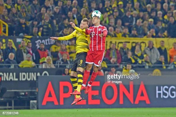 Andrey Yarmolenko of Dortmund and Thiago of Bayern Muenchen battle for the ball during the German Bundesliga match between Borussia Dortmund v Bayern...