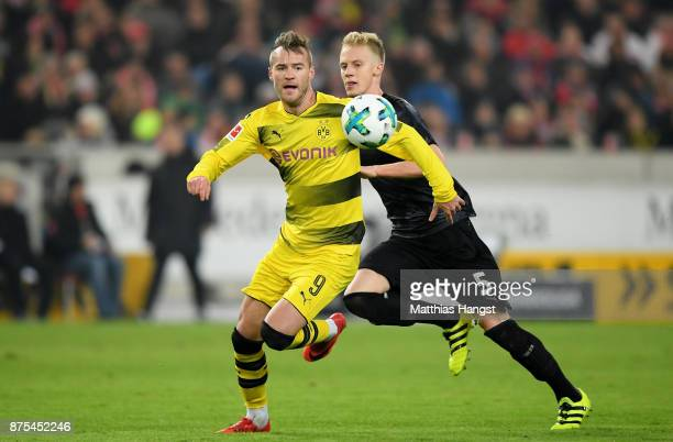 Andrey Yarmolenko of Dortmund is challenged by Timo Baumgartl of Stuttgart during the Bundesliga match between VfB Stuttgart and Borussia Dortmund at...