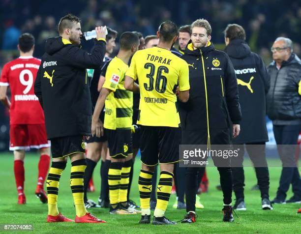 Andrey Yarmolenko of Dortmund Jeremy Toljan of Dortmund Oemer Toprak of Dortmund and Andre Schuerrle of Dortmund looks dejected after the German...