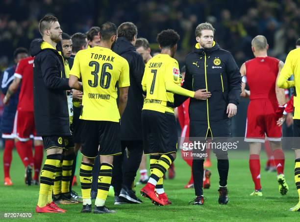 Andrey Yarmolenko of Dortmund Oemer Toprak of Dortmund Jadon Sancho of Dortmund and Andre Schuerrle of Dortmund looks dejected after the German...