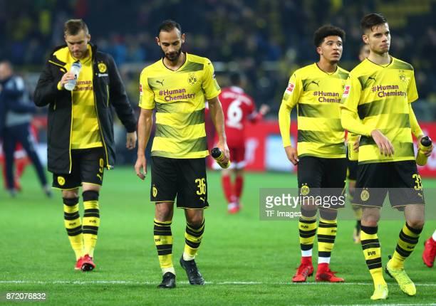 Andrey Yarmolenko of Dortmund Oemer Toprak of Dortmund Jadon Sancho of Dortmund and Julian Weigl of Dortmund looks dejected after the German...