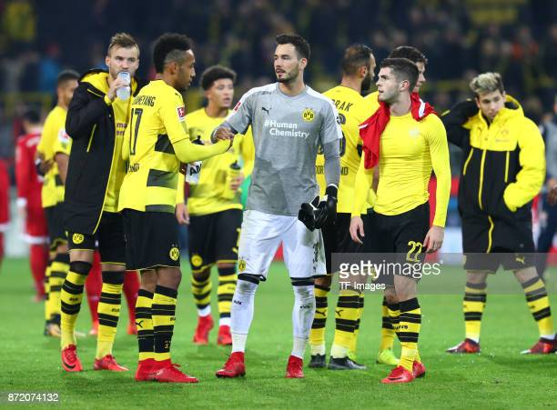 Andrey Yarmolenko of Dortmund PIe and Roman Büerki Christian Pulisic of Dortmund and Raphael Guerreiro of Dortmund looks dejected after the German...