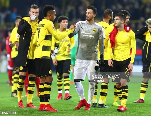 Andrey Yarmolenko of Dortmund PierreEmerick Aubameyang of Dortmund and Roman Bürki and Christian Pulisic of Dortmund looks dejected after the German...