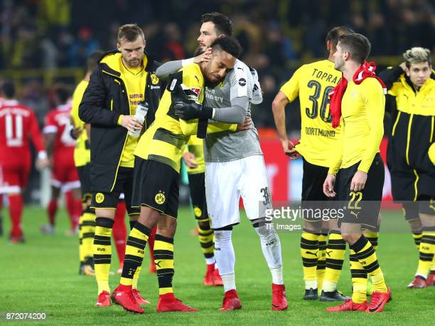 Andrey Yarmolenko of Dortmund PierreEmerick Aubameyang of Dortmund and Roman Bürki Oemer Toprak of Dortmund and Christian Pulisic of Dortmund looks...