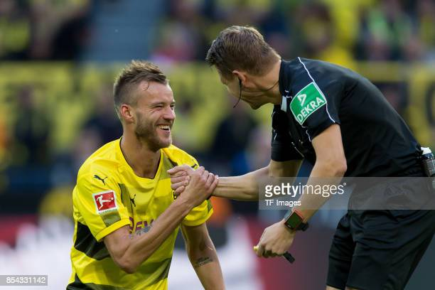 Andrey Yarmolenko of Dortmund shakes hands with Referee Patrick Ittrich during the Bundesliga match between Borussia Dortmund and 1 FC Koeln at the...