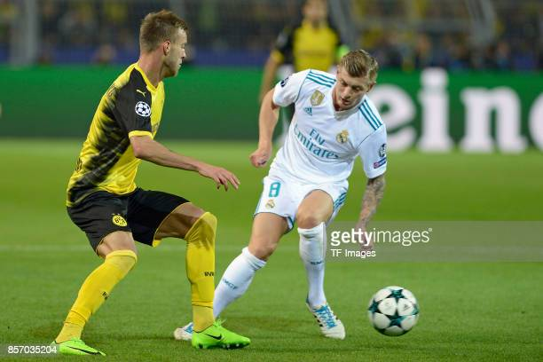 Andrey Yarmolenko of Dortmund Toni Kroos of Real Madrid battle for the ball during the UEFA Champions League group H match between Borussia Dortmund...