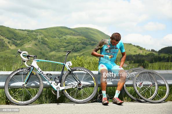 Andrey Zeits of Kazakhstan and Astana sits on the road barrier awaiting assistance after a crash during the eleventh stage of the 2014 Giro d'Italia...