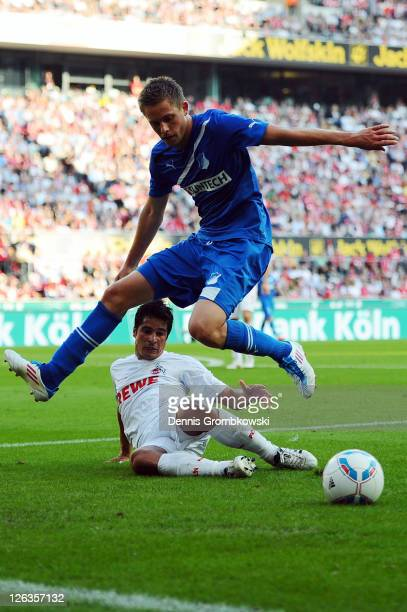 Andrezinho of Koeln challenges Gylfi Sigurdsson of Hoffenheim during the Bundesliga match between 1 FC Koeln and 1899 Hoffenheim at...