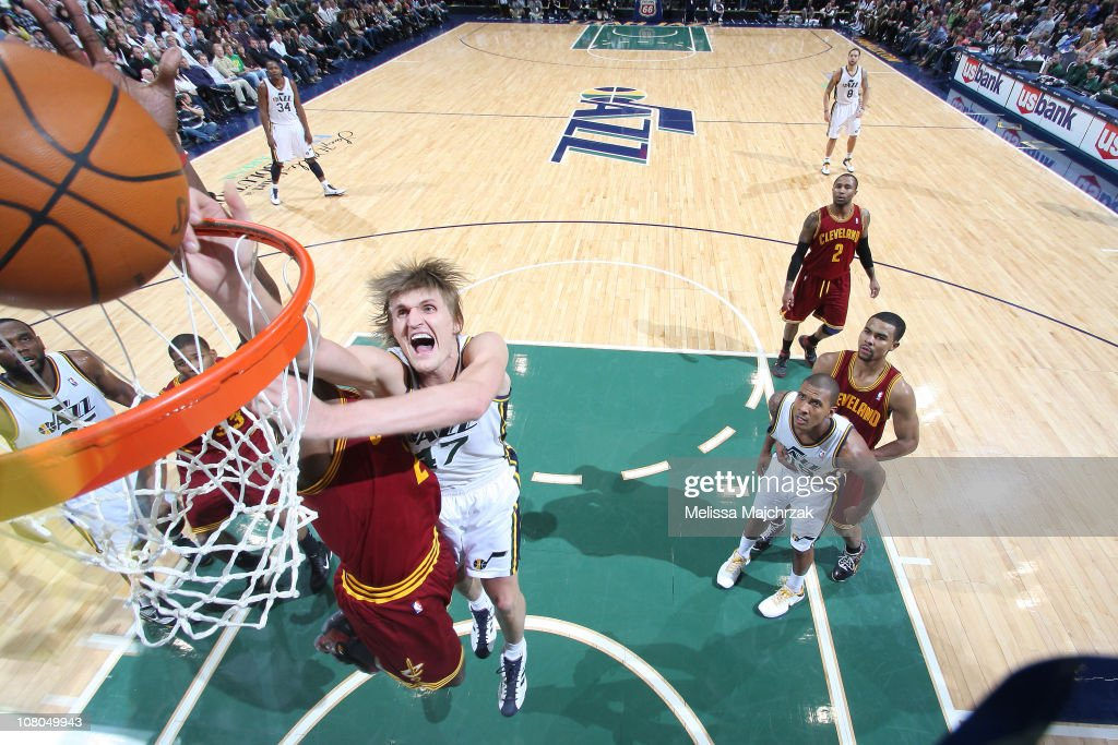 Andrie Kirilenko #47 of the Utah Jazz goes for the layup against J.J. Hickson #21 of the Cleveland Cavaliers at EnergySolutions Arena on January 14, 2011 in Salt Lake City, Utah.