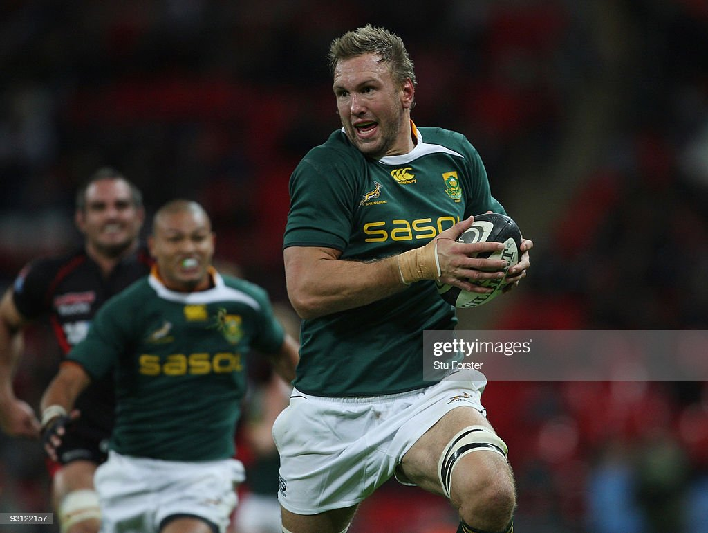 Andries Bekker of South Africa charges through the Saracens defence during the friendly match between Saracens and South Africa at Wembley Stadium on...