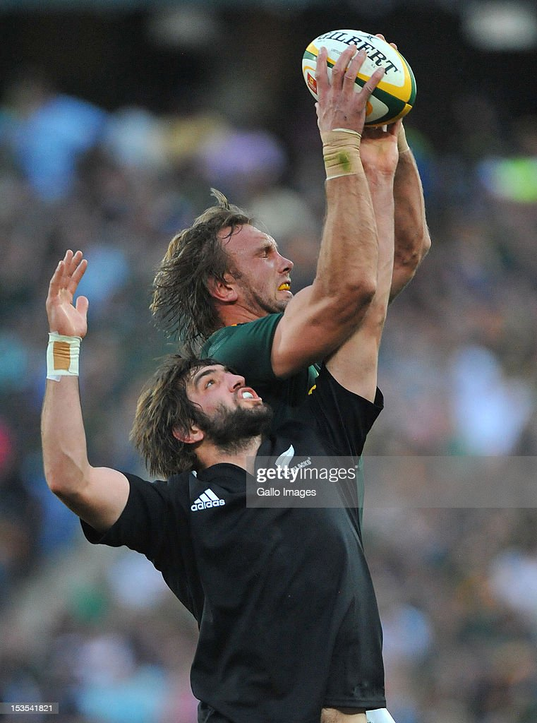 Andries Bekker of South Africa wins the ball from Sam Whitelock of New Zealand during the Rugby Championship match between South Africa Springboks...