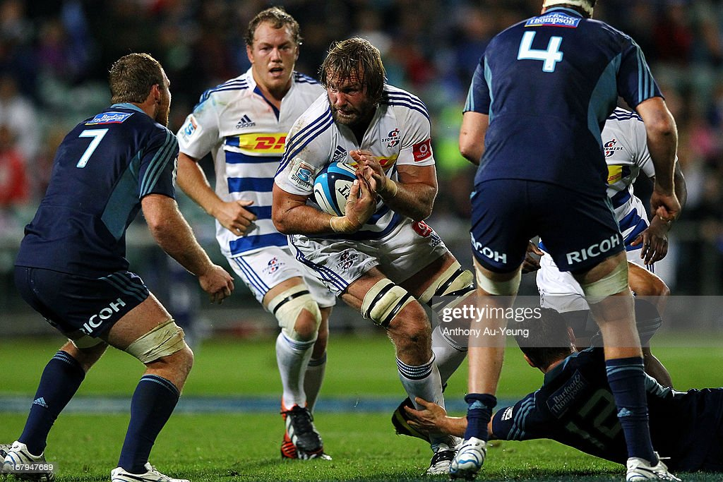Andries Bekker of the Stormers charges at Luke Braid of the Blues during the round 12 Super Rugby match between the Blues and the Stormers at North...