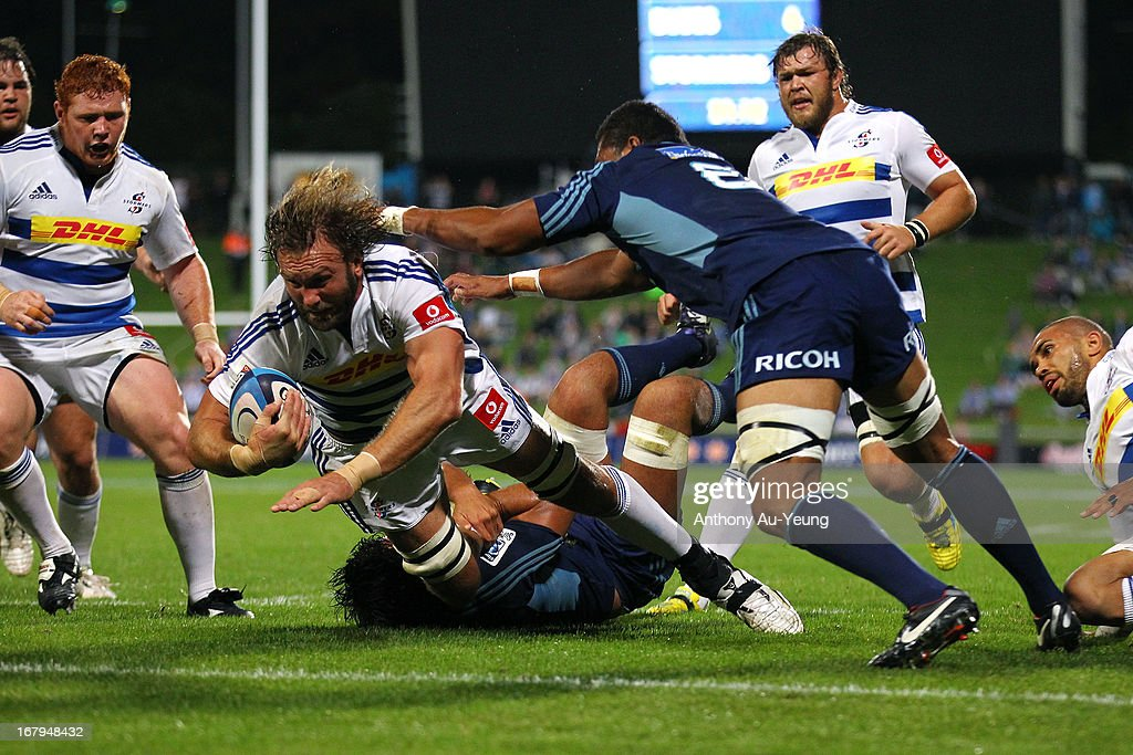 Andries Bekker of the Stormers dives for the try in the first half during the round 12 Super Rugby match between the Blues and the Stormers at North...