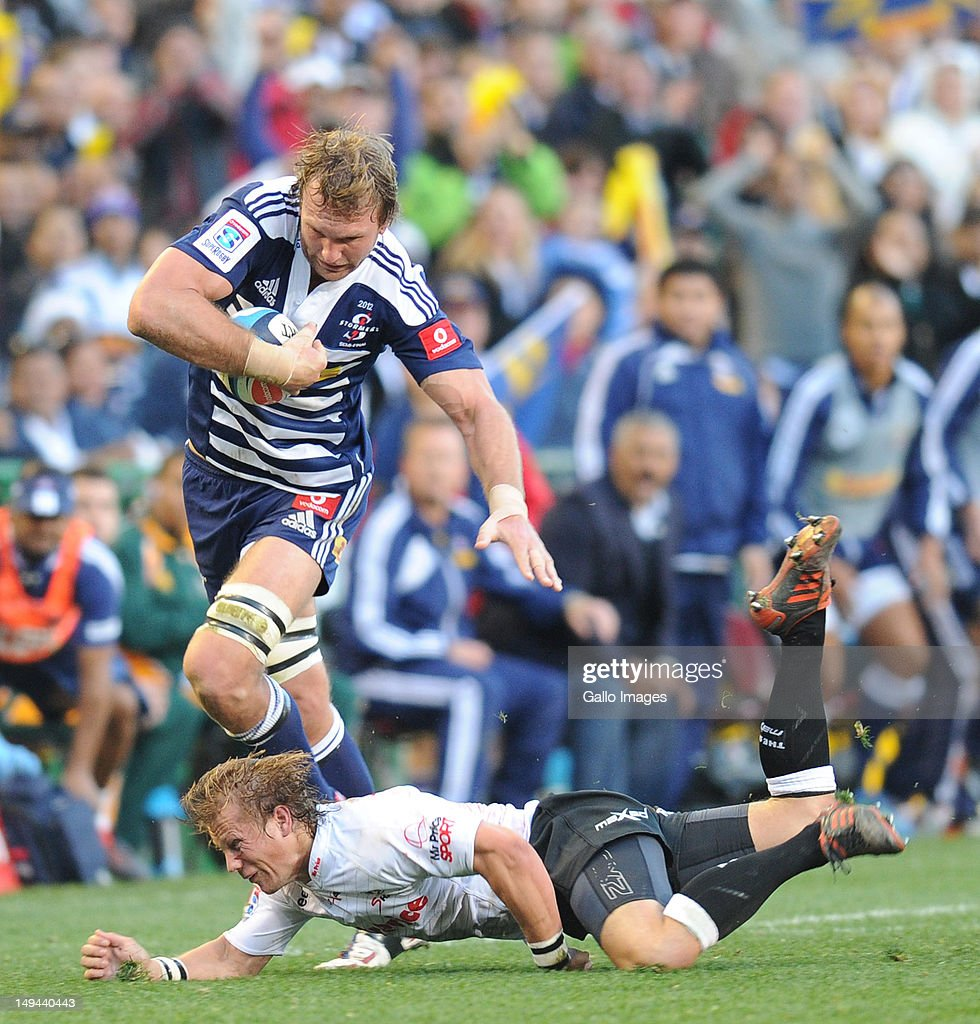 Andries Bekker of the Stormers hands off Charl McLeod of the Sharks during the Super Rugby semi final match between DHL Stormers and The Sharks from...