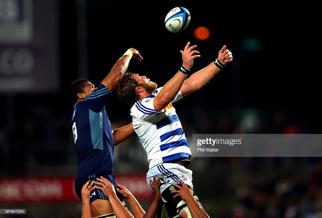 Andries Bekker of the Stormers takes the ball in the lineout over Peter Saili of the Blues during the round 12 Super Rugby match between the Blues...