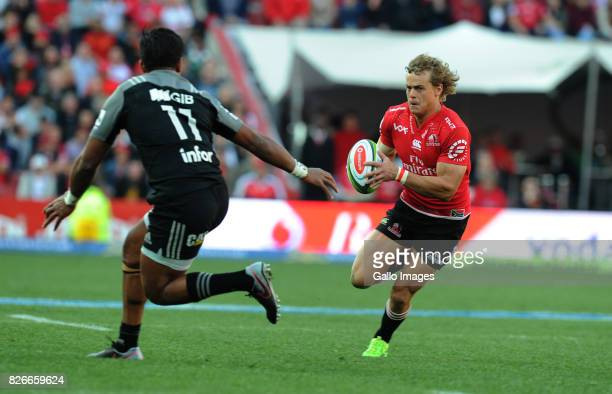 Andries Coetzee of Lions is tackled by Seta Tamanivalu of Crusaders during the Super Rugby Final match between Emirates Lions and Crusaders at...