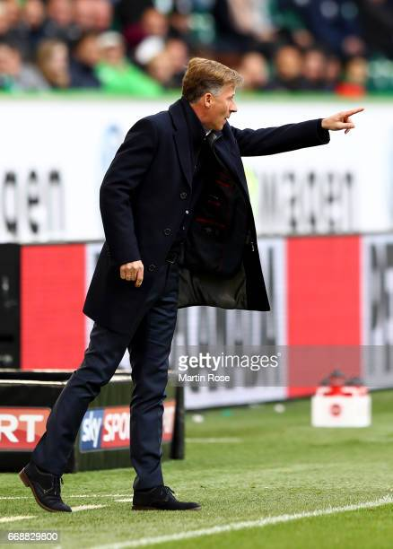 Andries Jonker head coach of Wolfsburg gives instructions during the Bundesliga match between VfL Wolfsburg and FC Ingolstadt 04 at Volkswagen Arena...