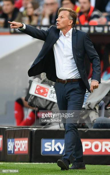 Andries Jonker head coach of Wolfsburg gives instructions to his players during the Bundesliga match between Bayer 04 Leverkusen and VfL Wolfsburg at...