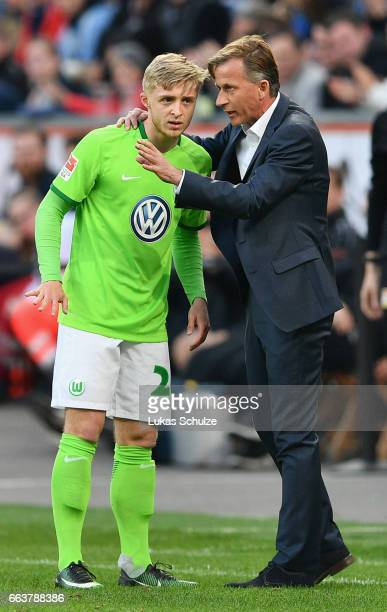 Andries Jonker head coach of Wolfsburg gives instructions to Justin Möbius during the Bundesliga match between Bayer 04 Leverkusen and VfL Wolfsburg...