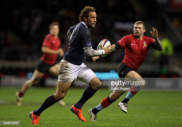 Andries Strauss of the Southern Hemisphere XV looks to pass as Sean Long of the H4H Northern Hemisphere XV closes in during the Help For Heroes Rugby...