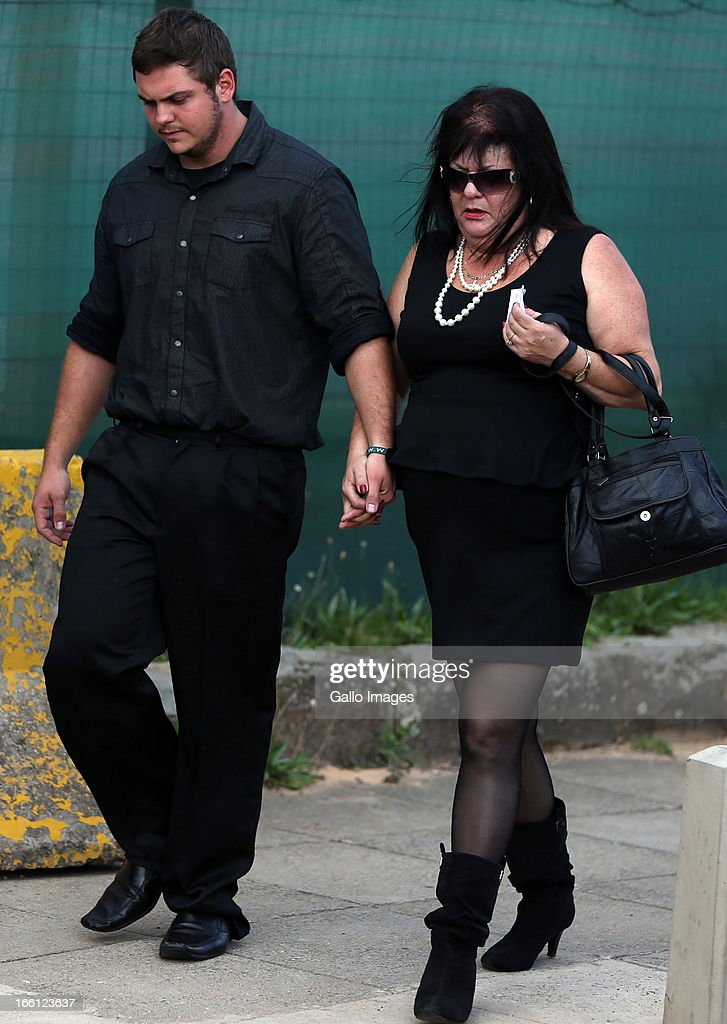 Andries Van Der Merwe with his mother outside court after his bail application on April 8, 2013 in Durban, South Africa. Van Der Merwe is one of the accused charged with the murder of a British Royal Marine, Brett Williams. Williams was beaten to death at a Super XV Match at Durban Stadium.