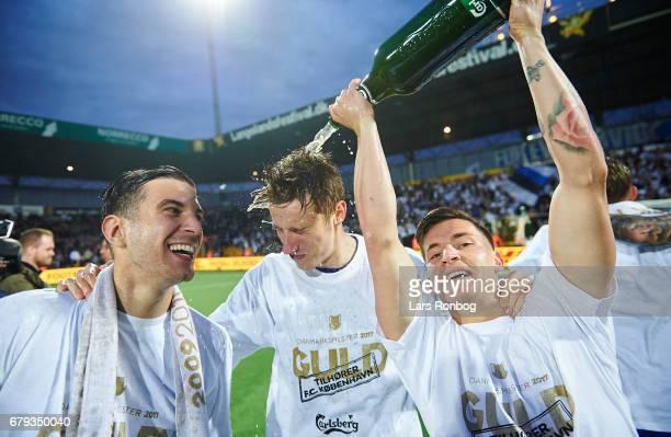 Andrija Pavlovic Jan Gregus and Benjamin Verbic of FC Copenhagen celebrate with champagne as danish champions after the Danish Alka Superliga match...