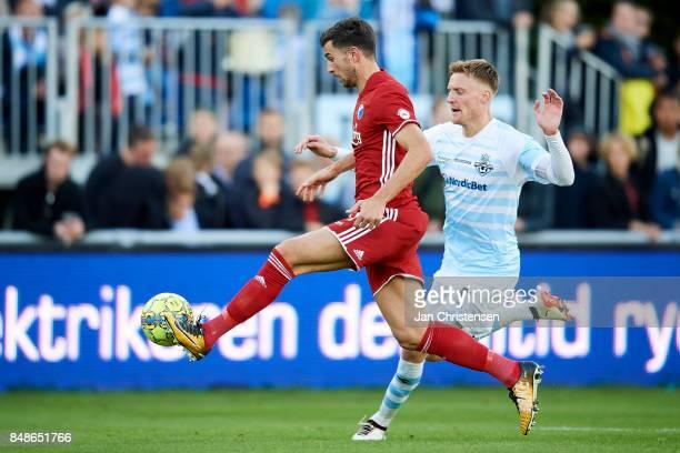 Andrija Pavlovic of FC Copenhagen and Andreas Holm of FC Helsingor compete for the ball during the Danish Alka Superliga match between FC Helsingor...