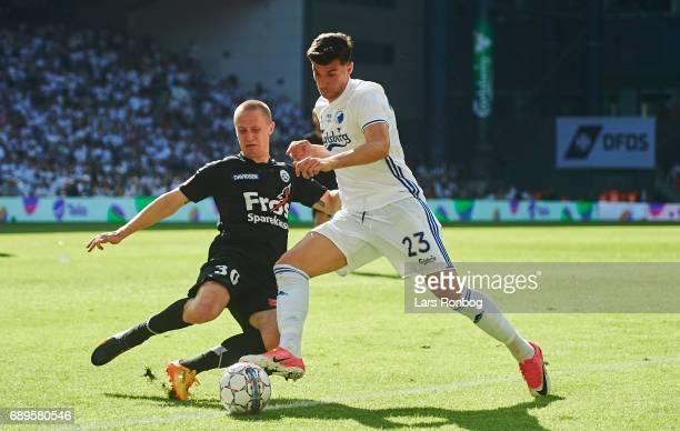 Andrija Pavlovic of FC Copenhagen and Marcel Romer of Sonderjyske compete for the ball during the Danish Alka Superliga match between FC Copenhagen...