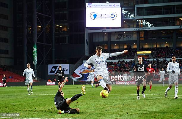 Andrija Pavlovic of FC Copenhagen and Pierre Kanstrup of Sonderjyske compete for the ball during the Danish Alka Superliga match between FC...