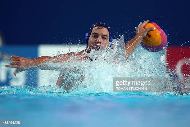 Andrija Prlainovic of Serbia looks to pass the ball during the men's final water polo match between Croatia and Serbia on day fifteen of the 16th...