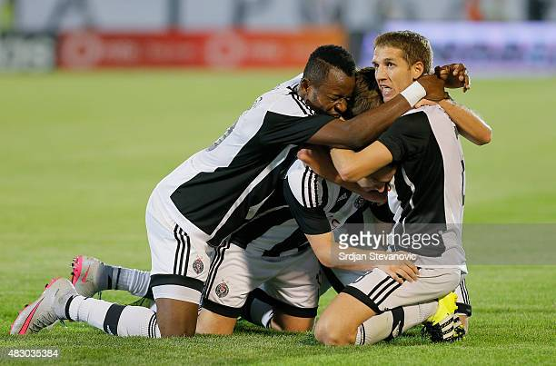 Andrija Zivkovic of FC Partizan Belgrade celebrates his goal with team mates Oumarou Aboubakar and Darko Brasanac during the UEFA Champions League...