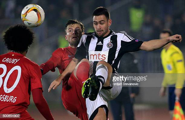 Andrija Zivkovic of FK Partizan competes for the ball against Philipp Max of FC Augsburg during the UEFA Europa League match between FK Partizan v FC...